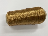 Polyvisco Bast Raffia effect  color goldish 200 meter/cone